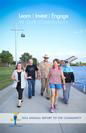 Newsletter Cover showing adults walking down boardwalk